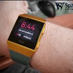 person wearing fitbit Ionic watch