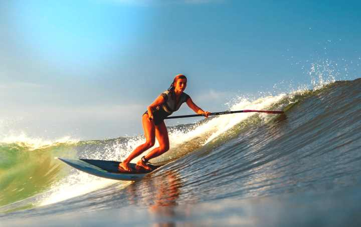 Woman surfing and wearing smartwatch
