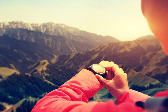 Woman hiker checking watch
