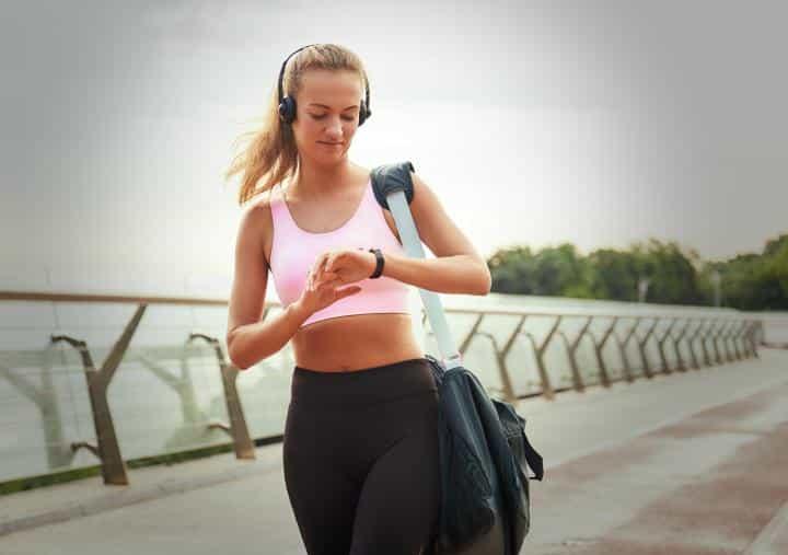 woman wearing a smartwatch like fitbit alta