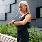 woman athlete looking at smartwatch