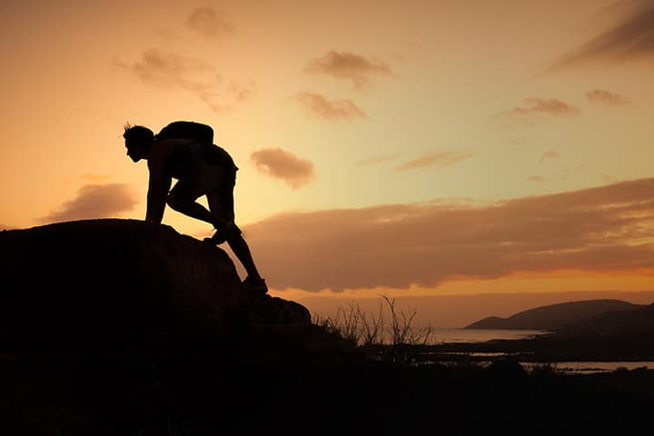 Silhouette of man mountaining