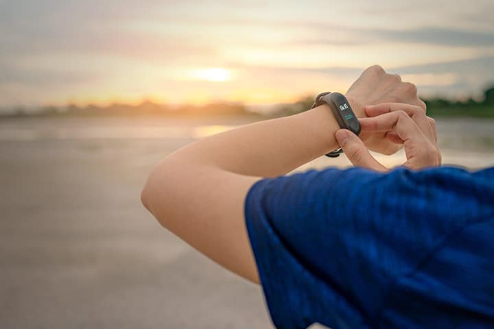Person checking fitness on Fitbit smartwatch