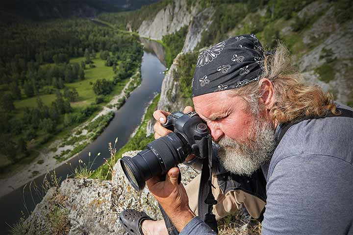Man photographing valley