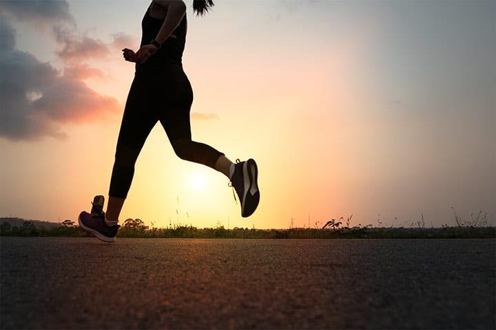 solar charging, woman running in sunset