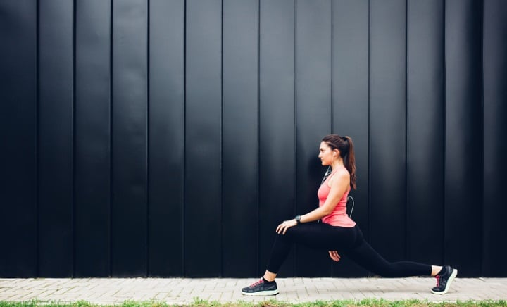 woman exercising wearing smartwatch