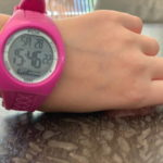 Pink smart watch worn by girl