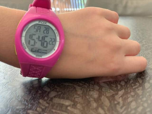 Pink smart watch worn by girl