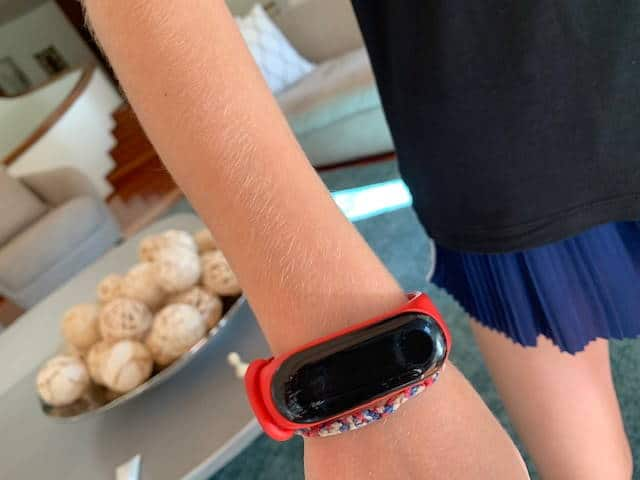 child wearing smartwatch