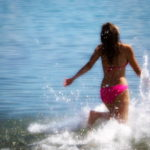 Girl walking into the sea