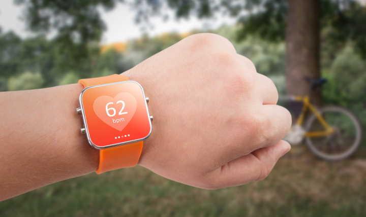 Orange smartwatch on boys wrist