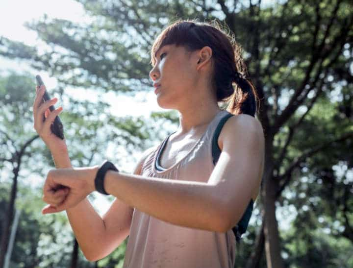 Woman with samsung galaxy watch 4 and phone