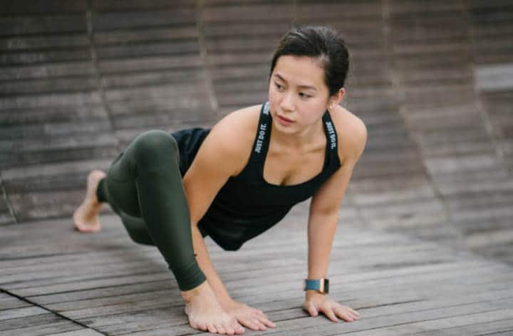 woman doing yoga with smartwatch