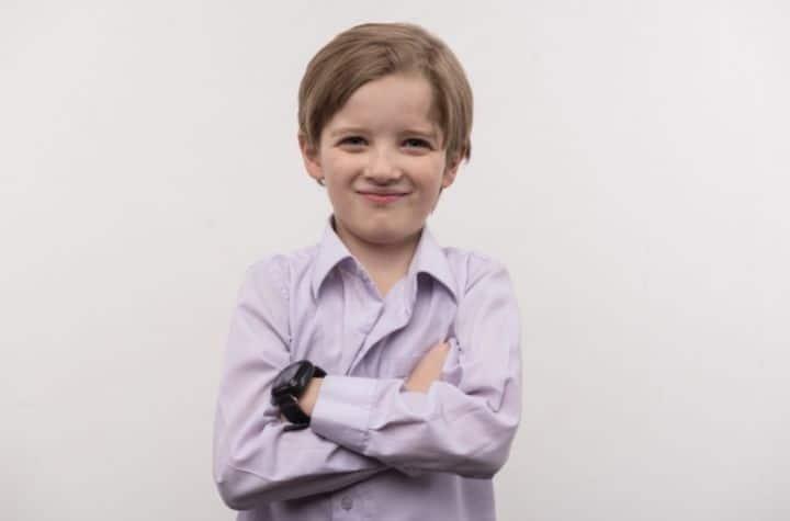 young boy wearing Xplora X5 Play