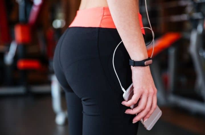 close up of sports woman trying the best fitness bands