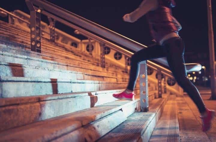 woman jogging at night with garmin forerunner 945