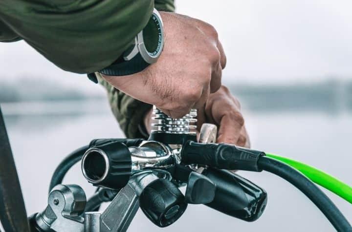man setting up dive gear wearing sekio prospex dive watch