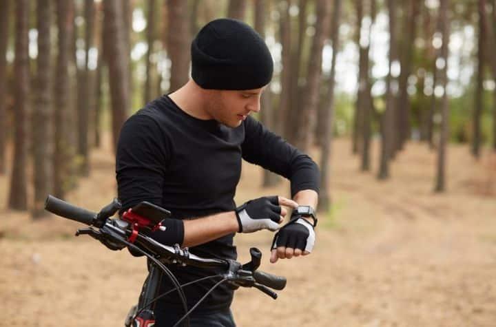 man on bike using Garmin GPS watches