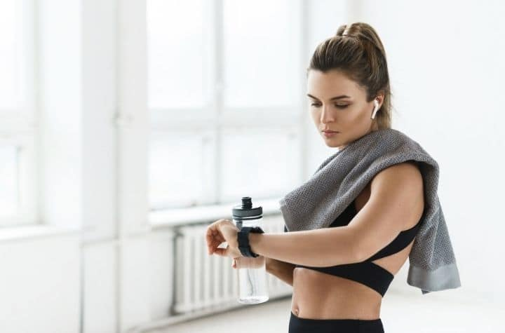 Young woman using best garmin fitness trackers