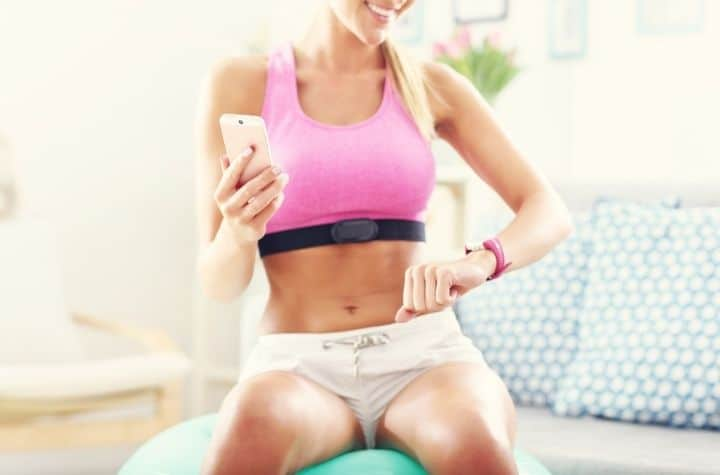 sports woman using heart rate monitor watches