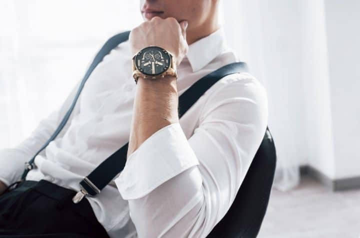 stylish man wearing luxury watch from the top 20 watch brands