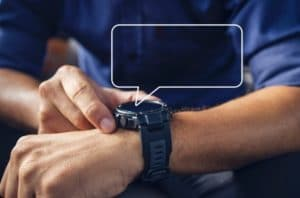 business man using one of the touchscreen watches