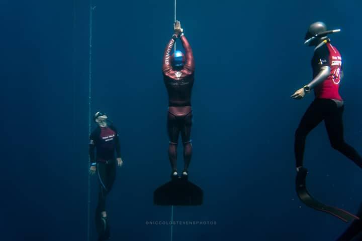 Freediver competing wearing Garmin Descent Mk1