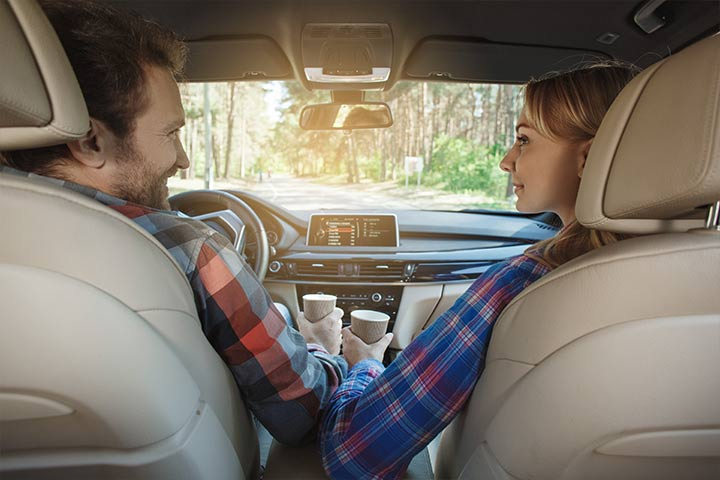 Man and woman sitting in a car