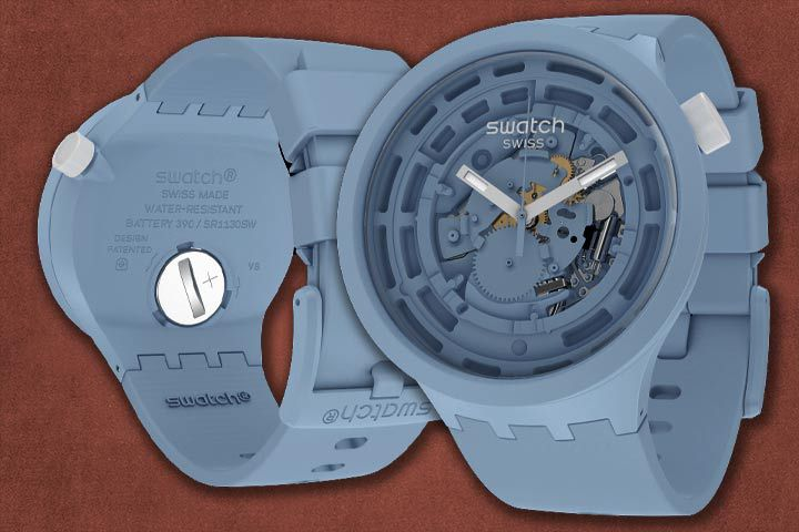 front and back design of Swatch Bioceramic C-Blue with rusty red background