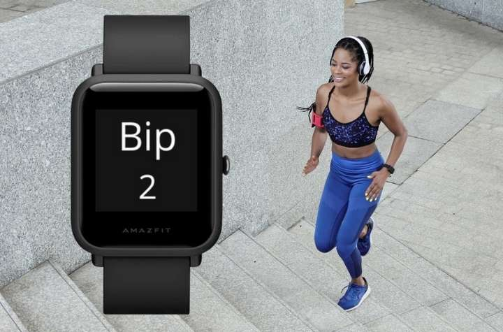 Amazfit Bip 2 in front of woman running up steps