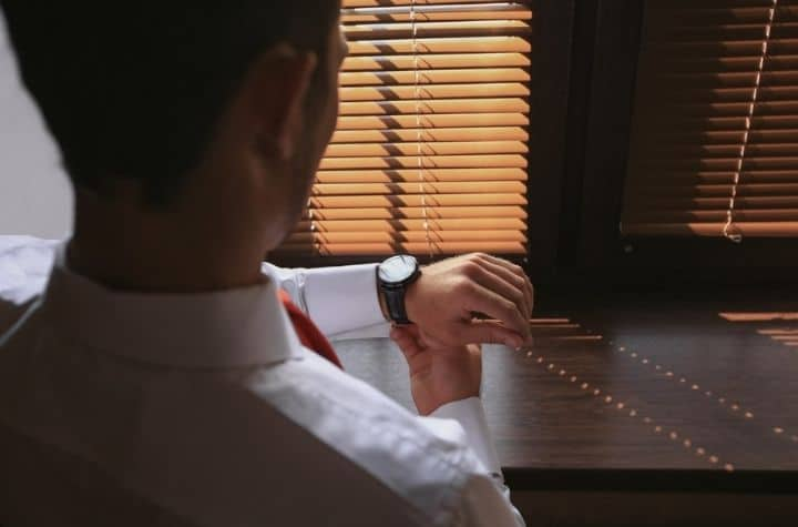 businessman looking at Armani Exchange Watches