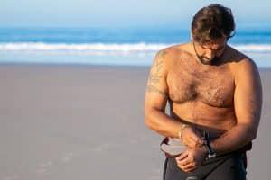 male surfer wearing his watch